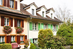 Characteristic houses with flowers at the windows in Bremgarten, Switzerland Royalty Free Stock Photography