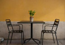 Characteristic Italian restaurant with chairs and table outside stock photo