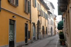 Characteristic narrow street with Christmas illuminations in Crema in the province of Cremona in Lombardy (Italy) Royalty Free Stock Photography