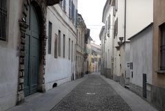Characteristic narrow street in Crema in the province of Cremona in Lombardy (Italy) Stock Photography