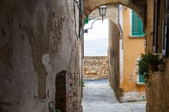 Characteristic narrow street in Montepulciano, a medieval town near Siena in the heart of Tuscany countryside, Italy. Europe Royalty Free Stock Photo