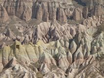 Characteristic panorama of the capadoccia with pink and yellow colored rocks in a suggestive atmosphere. Turkey. Characteristic panorama of the Capadoccia with Royalty Free Stock Photo