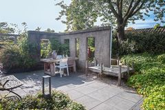 Characteristic patio with an opportunity to sit and relax. Apeltern, Netherlands, September 29, 2017: Characteristic patio with an opportunity to sit and relax Stock Photos