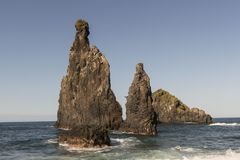 Rocks in the sea on the island of Madeira. Characteristic rocks bathed by the sea on the island of Madeira, Portugal stock photos