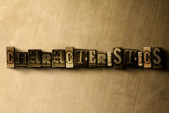 CHARACTERISTICS - close-up of grungy vintage typeset word on metal backdrop Stock Photos