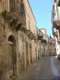 Characteristic antique street of Ragusa Ibla with antique buidings and balconies. Sicily. Italy. Characteritic antique street of Ragusa Ibla. Characteristic Royalty Free Stock Image