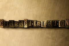CHARACTERIZATION - close-up of grungy vintage typeset word on metal backdrop Royalty Free Stock Images