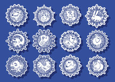 Characters Chinese zodiac signs in the snowflake. Characters Chinese zodiac signs in the white snowflakes on a blue background.Vector illustration Stock Images