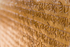 Characters of indian hieroglyphs on sandstone wall. Royalty Free Stock Photos