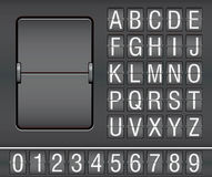 Characters and numbers on mechanical scoreboard Royalty Free Stock Images