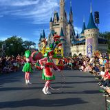 Characters performancing at Walt Disney World Christmas party. Characters lady elf elves singing and dancing in front of Cinderella Castle at Christmas holiday Stock Photography