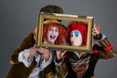 Characters from wonderland crazy hatter and red queen Royalty Free Stock Images