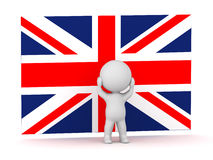 Charakter 3D wird vor britischer Flagge Union Jack betont Stockbilder