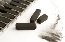 Charbon de bois de retrait noir Images stock