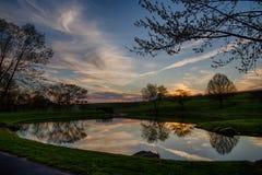 Charca de la puesta del sol Foto de archivo libre de regalías