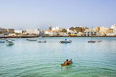 Charco de San Gines in Arresife with boy in a small canoe Royalty Free Stock Photo