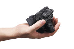 Charcoal. Man holding lumps of charcoal in his hand Stock Photos