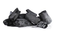 Charcoal. Lumps of black charcoal on white Royalty Free Stock Photos