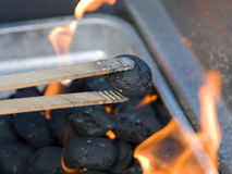 Charcoal. Outdoor image of a barbecue grill with burning coal and barbecue tongs Stock Photography
