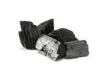 Charcoal. Pile of a charcoal on the white background Stock Photos