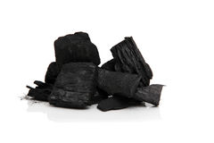 Charcoal. Black charcoal isolated on white Royalty Free Stock Image