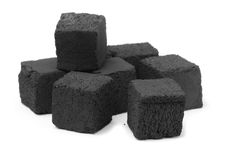 Charcoal. Group of charcoal cubes on white stock images