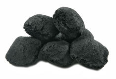 Charcoal. A small pile of charcoal briquettes isolated on white Royalty Free Stock Photos