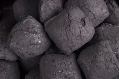 Charcoal. Briquettes background close up full frame Royalty Free Stock Images