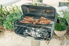Barbecue with ribs and steak Stock Photos