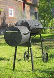 Charcoal BBQ grill. Charcoal BBQ grill on the backyard Stock Image