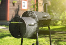 Charcoal BBQ grill. Charcoal BBQ grill on the backyard Royalty Free Stock Photos