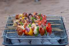 Charcoal bbq of kebabs in the desert stock photos