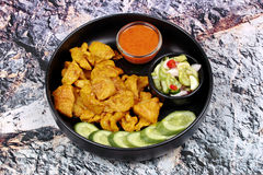 Charcoal boiled ,Pork satay served with side disk. Stock Images