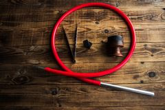 Charcoal bowl hose for shisha on a wooden background royalty free stock photos