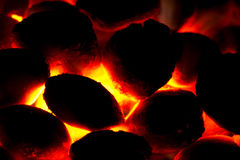 Charcoal bricket fire for barbecue. With flaming heat Stock Image