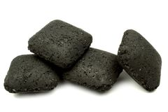 Charcoal briquettes. Close up charcoal briquettes on white background Royalty Free Stock Photos