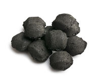 Charcoal briquettes. On white background Royalty Free Stock Photography