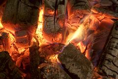 Charcoal Briquettes Glow In BBQ Grill Pit Background Texture Stock Image