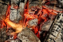 Charcoal Briquettes Glow In BBQ Grill Pit Background Texture Stock Images