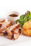 Charcoal Broiled Pork Neck. With Jaew thai style spicy sauce and fried sticky rice royalty free stock images