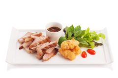 Charcoal Broiled Pork Neck. With Jaew thai style spicy sauce and fried sticky rice isolated on white royalty free stock photo
