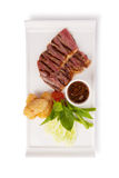 Charcoal Broiled Pork Neck. With Jaew thai style spicy sauce and fried sticky rice isolated on white stock images