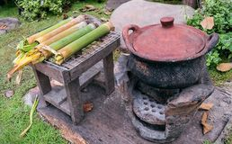 Charcoal and clay pots. Charcoal clay pots and traditional kitchen cooking spawned stock photos