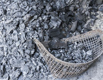 Charcoal. Close up pile of charcoal with bamboo basket Stock Photo