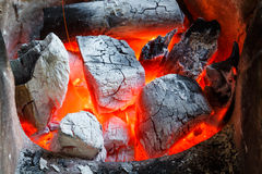 Charcoal fire. Glowing red hot fire with burning charcoal Royalty Free Stock Photos