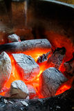 Charcoal fire. Glowing red hot fire with burning charcoal Royalty Free Stock Photo