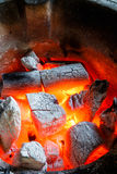 Charcoal fire. Glowing red hot fire with burning charcoal Stock Photo