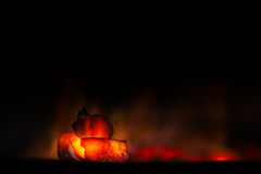 Charcoal with fire with black background Royalty Free Stock Photo