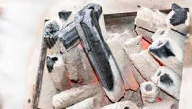 Charcoal in the fire place for a grill. Barbecue Royalty Free Stock Photos