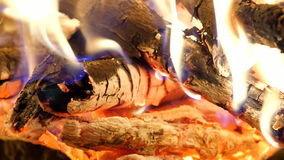 Charcoal and firewood burning. Burning woods shiver in hot air and gentle flames  fluorescing. stock video footage